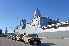 Naval Mobile Construction Battalion (NMCB) 4 humvees sit along the pier adjacent to USS San Diego (LPD 22) during a loading exercise, Jan. 26. (U.S. Navy/MC1 Rosalie Chang)