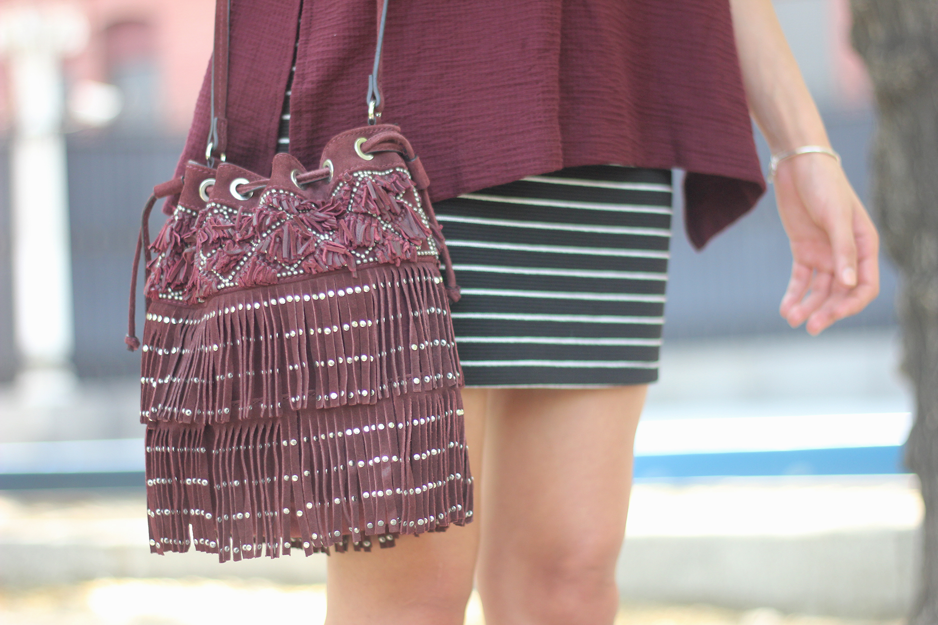 Striped Skirt With Burgundy T-shirt And Fringed Bag Summer Outfit24