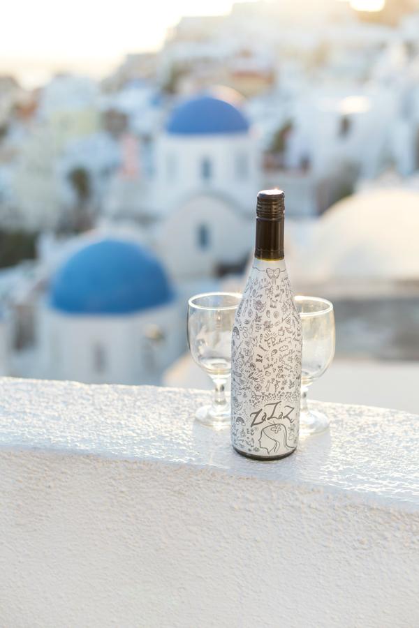 Cheers to Santorini Sunsets