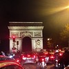 Rush hour in Paris at the Arc de Triumphe.