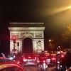 Rush hour in Paris at the Arc de Triumphe.