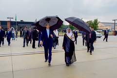 U.S. Secretary of State John Kerry and Saudi Arabian Foreign Minister Adel al-Jubeir walk across the tarmac at Andrews Air Force Base in Camp Springs, Maryland, on September 3, 2015, as they prepared under rainy skies to welcome King Salman bin Abdulaziz of Saudi Arabia upon his arrival to visit President Barack Obama. [State Department photo/ Public Domain]