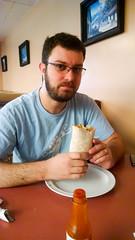 Mark eats Burrito