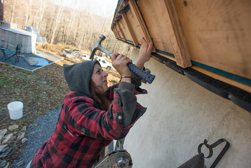 Tara Installing Plywood Stand-offs and Coravent Stripping to Strawbale Cottage Cold Roof Eaves in Preparation for Fascia Installation | by goingslowly