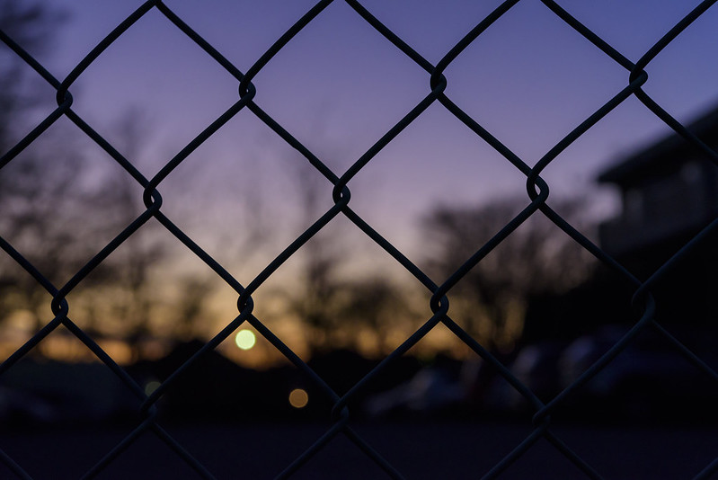 Sunset through fence