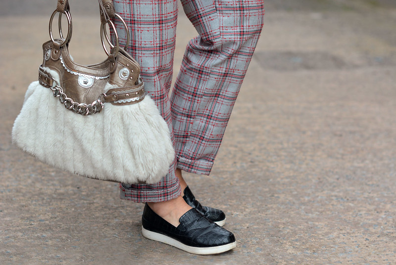 Plaid pants, faux fur bag, black slip-on shoes