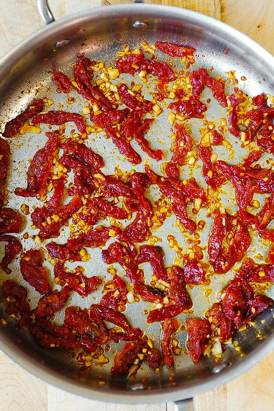 cooking sun-dried tomatoes with garlic
