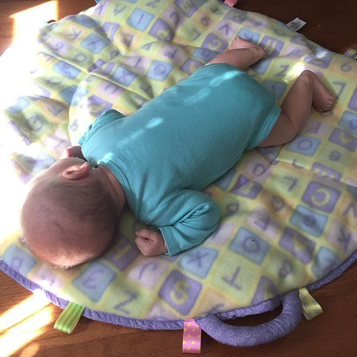 A girl after my own heart. So much for tummy time -- she fell asleep 30 seconds into it! We'll try again later. ????????????