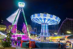 festival(0.0), ferris wheel(0.0), park(0.0), tourist attraction(1.0), outdoor recreation(1.0), fair(1.0), carousel(1.0), night(1.0), amusement ride(1.0), amusement park(1.0),