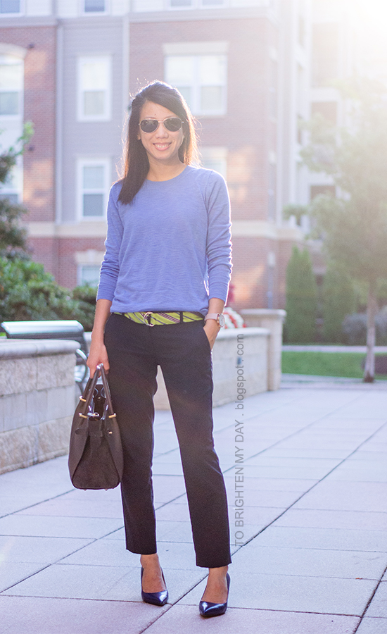 cornflower blue sweater, green striped belt, navy pants, oversized watch