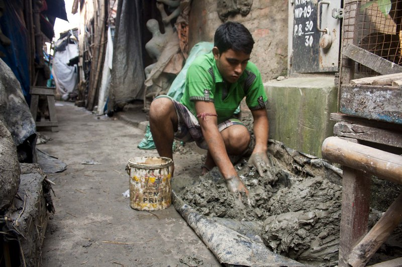 Clay is Processed for Making Idols - at Kumortuli, Kolkata, India
