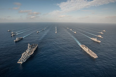 WATERS SOUTH OF JAPAN (Nov. 23, 2015) The Ronald Reagan Carrier Strike Group (RRNCSG) steams in formation with Japan Maritime Self-Defense Force ships during Annual Exercise (AE) 16. RRNCSG is participating in AE16 to increase interoperability between Japanese and American forces through training in air and sea operations. (U.S. Navy photo by Mass Communication Specialist 3rd Class Nathan Burke/Released)