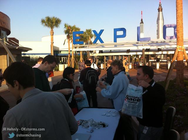 Thu, 11/01/2012 - 08:20 - NASA Social's Jason Townsend handing out swag and our credentials - November 01, 2012 8:20:45 AM - Merritt Island, Florida (28.5230,-80.6822)