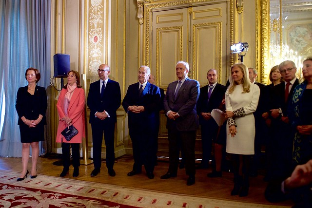 A Group of Dignitaries Listen as French Foreign Minister Jean-Marc Ayrault Prepares to Award Secretary Kerry the Grand Officer of the Légion d'honneur