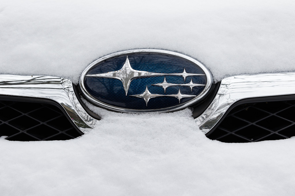 The snow-covered Subaru logo on the front of my XV Crosstrek