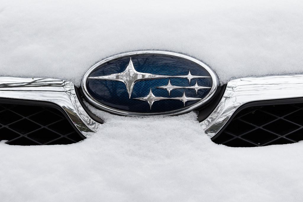 The snow-covered Subaru logo on the front of my XV Crosstrek