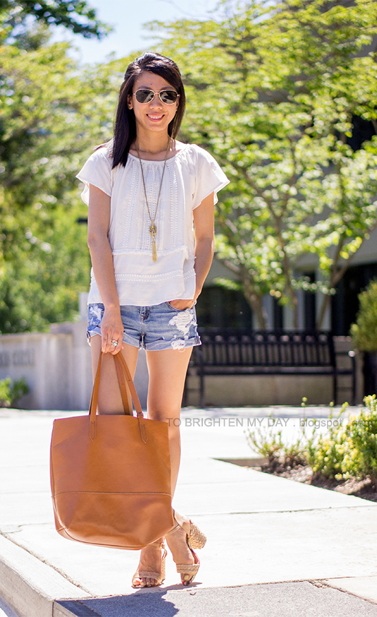 lace and crochet top, tassel necklace, ring with stones, distressed shorts, coganc brown tote, raffia sandals