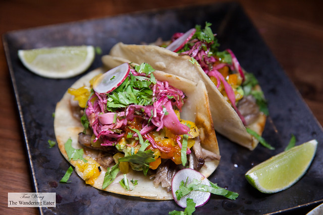 Taco Casero - pork, grilled pineapple pico de gallo, guacamole, pickled cabbage, crispy ginger