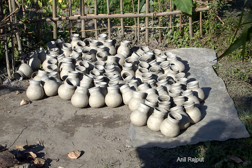 Earthen pots are first dried in open air and sun light