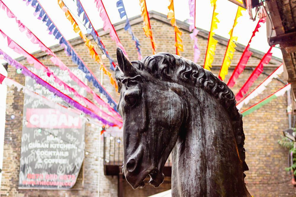 camden lock live horses head statue streamers