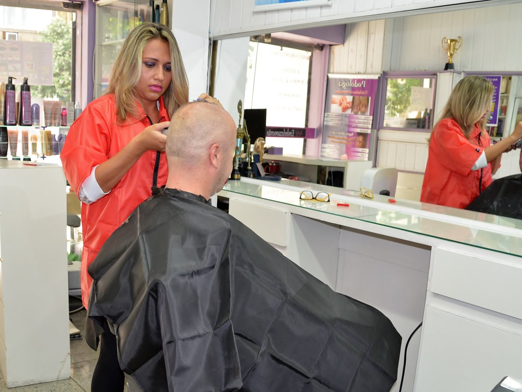 Barber shop women shaved their heads