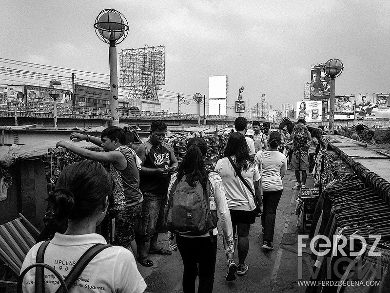 A pedestrian overpass full of vendors in Cubao