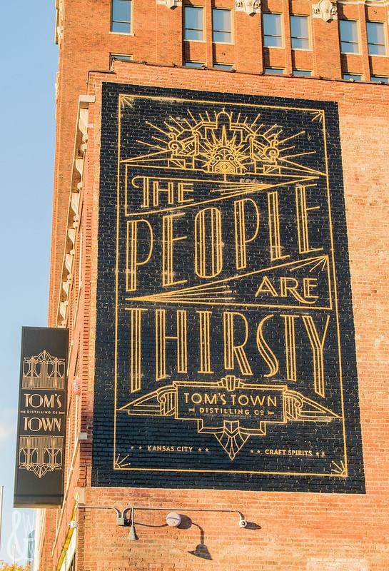Tom's Town Distillery Logo