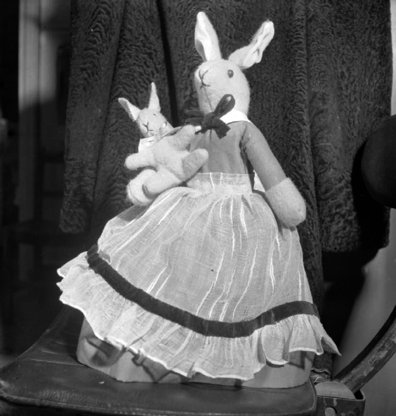Make-do Dolls For Christmas- Wartime Recycling, 1943 A portrait of a home-made stuffed cloth 'Mrs Brer Rabbit' and baby. According to the original caption, the apron of this children's toy was made from part of an old net curtain
