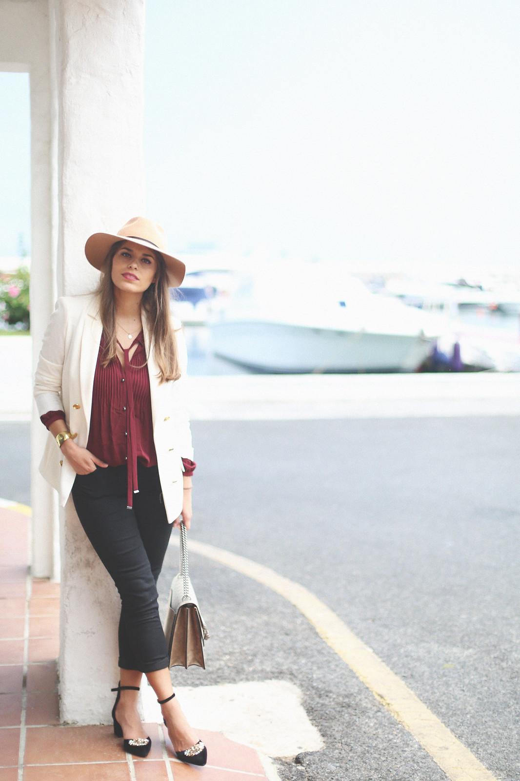 8. jessie chanes burgundy blouse cropped black jeans gucci bag