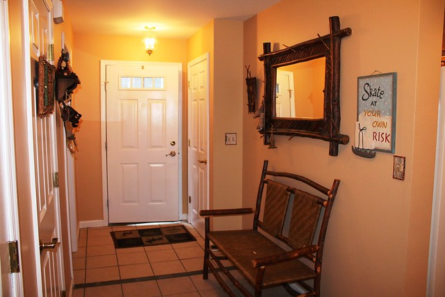 Large entry way with closet, utility room with washer/dryer and a full bathroom;