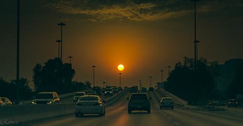 sunset urbanscape outdoor vehicle serene landscape sky twilight dusk bridge highway arabian