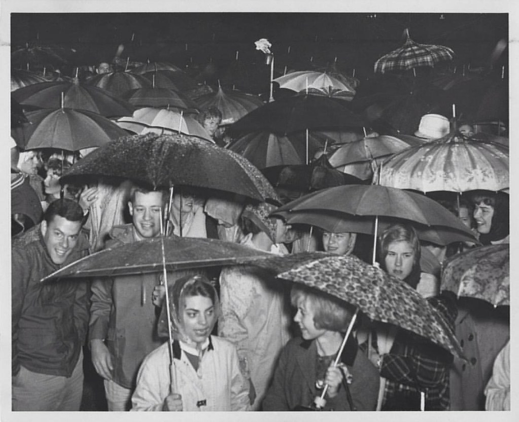#BBN is always #trueblue when it comes to cheering on the Wildcats, like these fans at @ukhomecoming in 1962. Rain or shine we look forward to seeing our alums & fans as @ukfootball takes on EKU tomorrow. #UK100HC #Raceto100 #OnOnUofK #AllIn  Photo by @ke