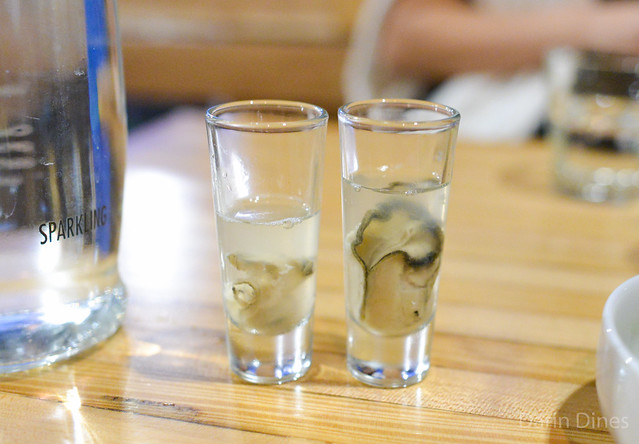 oyster shooter with salsa water