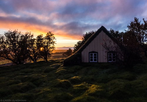 sunset church grass iceland hofskirkja unterwegsmiticelandtours photographyholidaywithicelandtours