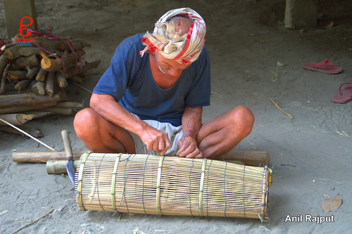 Mishing man making bamboo trap for fishing, Majuli Island