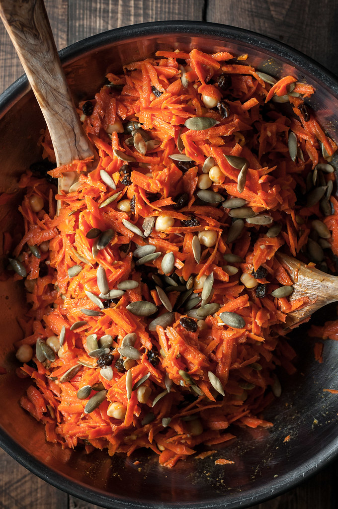 Easy carrot salad with pumpkin seeds, raisins, and chickpeas...and a super-tangy turmeric vinaigrette