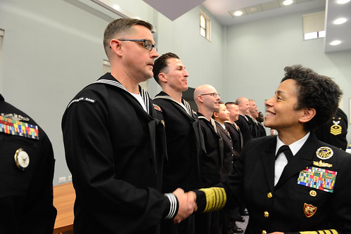 Fri, 01/27/2017 - 10:36 - 170127-N-SS492-557 NAVAL SUPPORT ACTIVITY NAPLES, Italy (Jan. 27, 2017) Commander, U.S. Naval Forces Europe-Africa, Adm. Michelle Howard, right, shakes hands with and presents a coin to Musician 1st Class Jeremy Saunders at the Commander, U.S. Naval Forces Europe-Africa Sailor of the Year ceremony Jan. 27, 2017.  U.S. Naval Forces Europe-Africa, headquartered in Naples, Italy, oversees joint and naval operations, often in concert with allied, joint, and interagency partners, to enable enduring relationships, and increase vigilance and resilience in Europe and Africa. (U.S. Navy photo by Chief Mass Communication Specialist Brian P. Biller/Released)