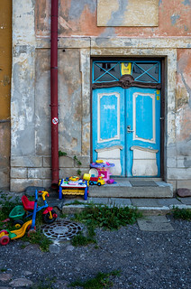 Plastic toys and crumbling house charm