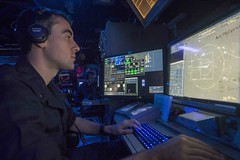Lt. j.g. Michael Cornish stands watch in the Combat Information Center (CIC) aboard the guided-missile cruiser USS Normandy (CG 60) during an air-defense exercise as a part of Malabar 2015. (U.S. Navy/MC3 Justin R. DiNiro)