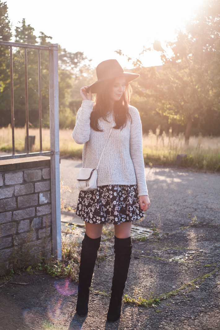 Outfit: wide brim hat, floral skirt, thigh high boots