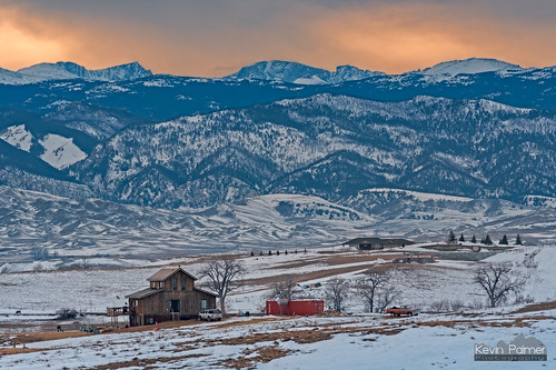 buffalo wyoming winter january cold snow snowy nikond750 nikon180mmf28 telephoto cabin wood wooden ranch house home bighornmountains bighornpeak loafmountain dartonpeak evening sunset sky gold golden colorful orange clouds trees foothills