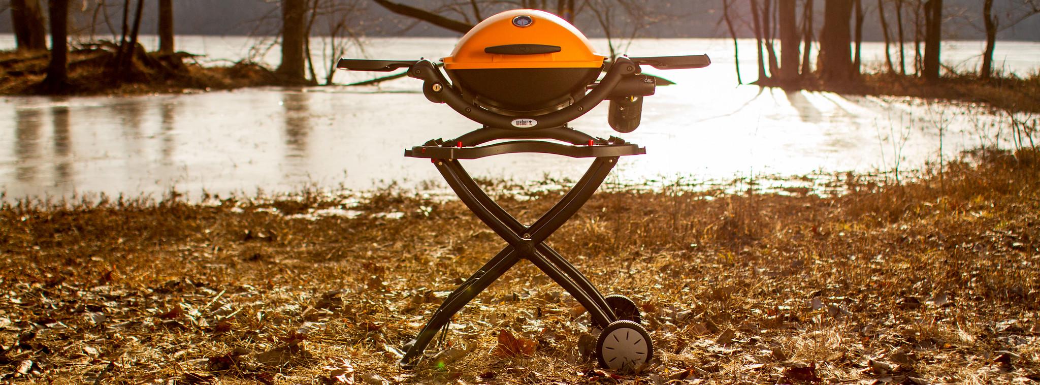 Orange Weber Q on Cart