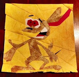 Ren from the Ren and Stimpy show.  10x10 paper pieced pattern.  Sewn by Jaylene Weber
