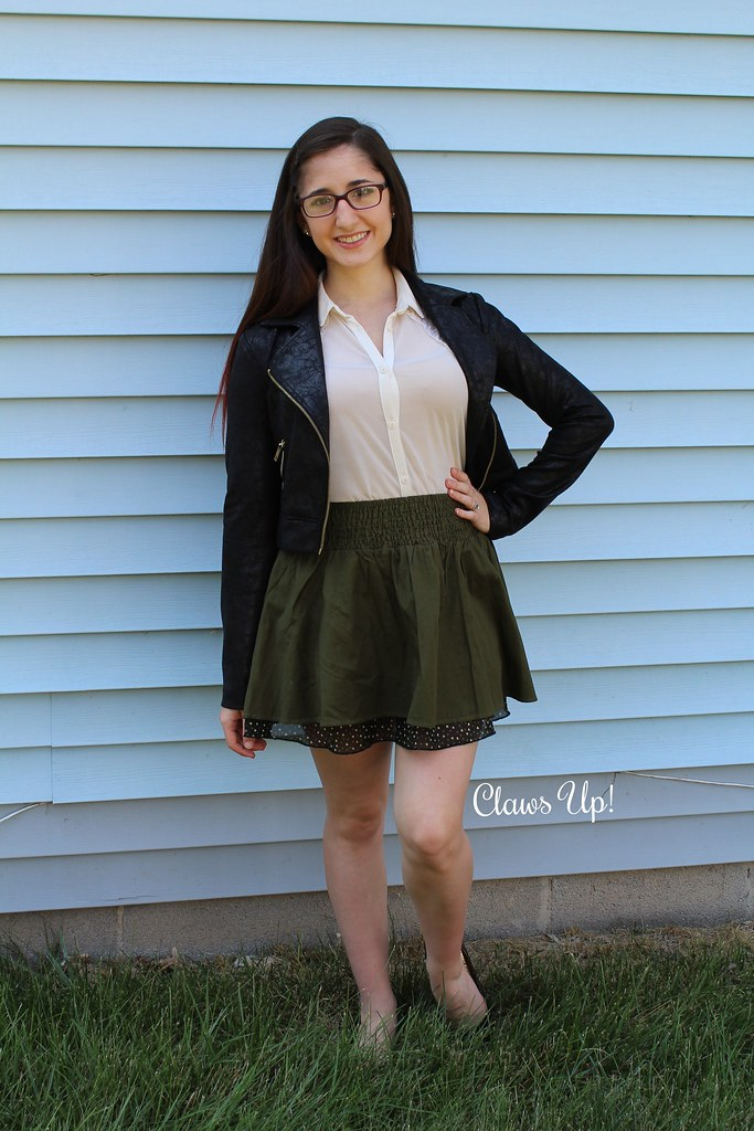 Black jacket, olive skirt, nude button down top.