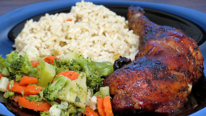 Barbecue chicken with rice pilaf and mixed vegetables