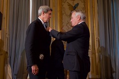 French Foreign Minister Jean-Marc Ayrault presents U.S. Secretary of State John Kerry the Grand Officer of the Légion d'honneur, the second-highest level of the French award, during a ceremony on December 10, 2016, at the Quai d'Orsay - the French Foreign Ministry - in Paris, France. [State Department Photo/ Public Domain]
