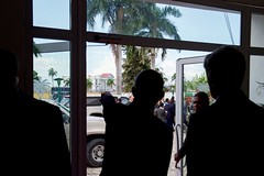 Haitian President Michel Martelly -- in silhouette -- shows U.S. Secretary of State John Kerry the rebuilt Presidential Palace, which was destroyed in the 2010 earthquake, before their bilateral meeting in Port-au-Prince, Haiti, on October 6, 2015. [State Department photo/ Public Domain]