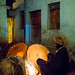 Harari man heating the drums before a ceremony in sufi community, Harari Region, Harar, Ethiopia by Eric Lafforgue