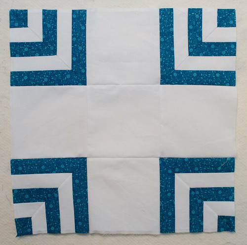 There are two basic blocks you need for a Carpenter's Square quilt top. This block is the simpler one.
