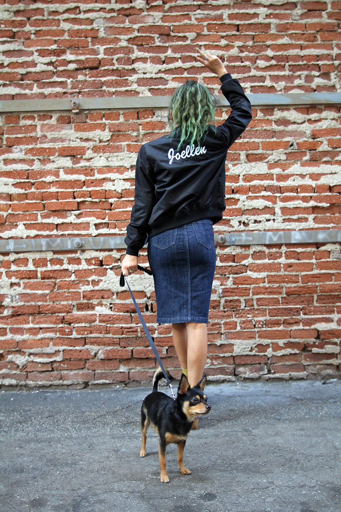 Vans customized name varsity jacket, Hart Denim pencil skirt, The Row round sunglasses, Chinese Laundry boots